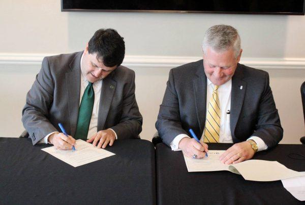 Faulkner and HCU Signing